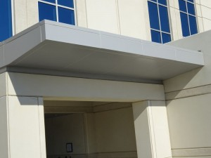 Millcreek Senior Center Aluminum composite system at side entrance by Alex Roofing Company, Inc.