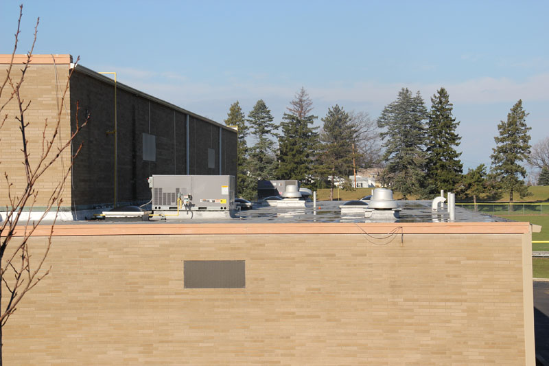 Commercial Roofing Project Mercyhurst College Gymnasium Erie, PA by Alex Roofing Company, Inc.